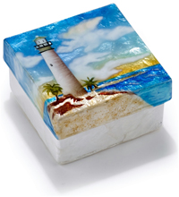 Lighthouse on tropical beach box.