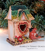Cardinal birdhouse with with heart-shape doorway.